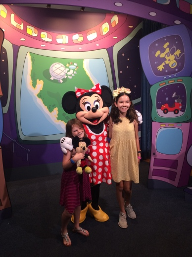 The girls visit Minnie Mouse at the character meet and greet at the Epcot Character Spot in Future World West.