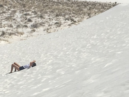 Relaxing on the cool white sand at White Sands National Monument